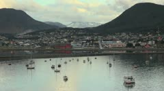Argentina Ushuaia u shaped mountains behind harbor Stock Footage