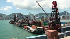 Docks in Hong Kong with the city's skyline in the background Stock Footage
