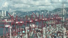 Hong Kong skyline behind container terminal and cranes China economy Stock Footage