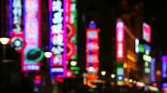 Neon signs above shops, Shanghai, China Stock Footage