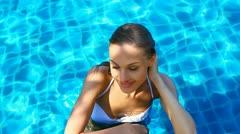 Cute girl in swimming pool Stock Footage