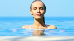 Sensual beauty in tropical pool Stock Footage