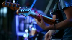 Guitars in live action at a concert (changes focus) - stock footage