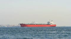 Red tanker ship sails in to Bosporus Sea Stock Footage