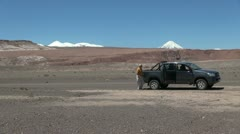 Chile Atacama man fetches hat in desert Stock Footage