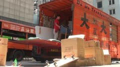 Movers are relocating furniture in Hong Kong - stock footage