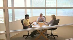 Group of coworkers at small conference table - stock footage