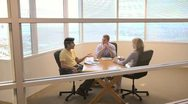 Group of coworkers at small conference table Stock Footage