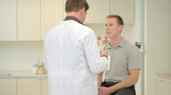Doctor consulting patient in clinic - stock footage