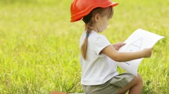Close-up portrait a little builder in the meadow Stock Footage