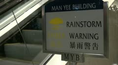 Rain storm warning sign in Chinese and English language Stock Footage