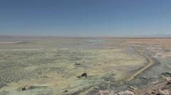 Chile Atacama Laguna Chaxa patterned mud zoom to birds 4 Stock Footage
