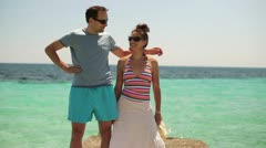Couple standing and chatting on beautiful stone pier by tropical sea HD Stock Footage