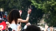 Stock Video Footage of Girl dancing over the shoulders at rock concert