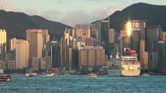 Luxury cruiseship sails past impressive Hong Kong skyline Stock Footage