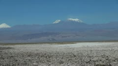 Chile Atacama Laguna Chaxa salt flat and mountain cones 40 Stock Footage