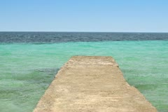 Stone pier by the beautiful tropical turquoise sea NTSC Stock Footage
