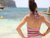 Woman standing on the beach by the beautiful sea NTSC Stock Footage