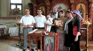 Christening of little baby in orthodox church (infant baptism) Stock Footage