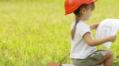 Little girl builder in the meadow Stock Footage