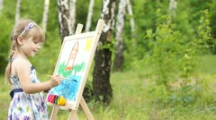 Amateur painter painting a picture - stock footage