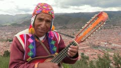Peru: Ethnic Man Plays and Sings Stock Footage