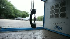 Stock Video Footage of Vandalized Payphone Booth - Camera Raw Footage