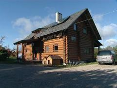 Log house solar collector Stock Footage