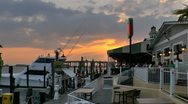 Stock Video Footage of Sunset over Destin harbor marina next to dock side restaurant