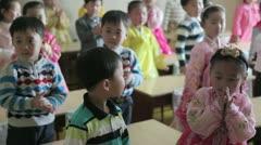 Schoolchildren singing in a classroom, North Korea Stock Footage