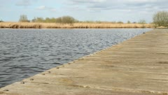 Lake view from a jetty - stock footage