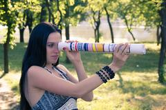 Girl with a telescope close Stock Photos