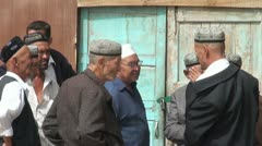 Uyghur men are discussing daily life, Chinese muslim minority people Stock Footage