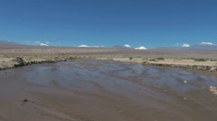 Chile Atacama mud flat stream bed zoom 2b Stock Footage