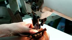 Sewing machines for sewing leather - stock footage