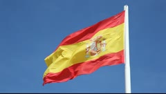 Spanish national flag against a blue sky - stock footage