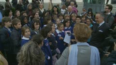 Berlusconii resigns, children sing! Stock Footage