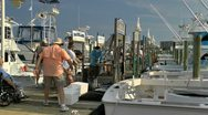 Stock Video Footage of Cleaning the afternoon deep sea fishing catch along Destin marina
