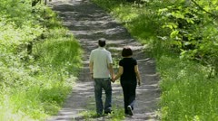 Couple walking on country road  4 Stock Footage