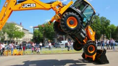 Demonstration of multifunctional tractor at the exhibition Stock Footage