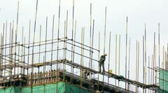 Time lapse of Construction workers atop building,China Stock Footage