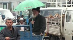 Kyrgyz man enters the livestock market in Kashgar, China Stock Footage