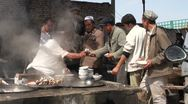 Stock Video Footage of Pouring hot soups into bowls of hard workers at the livestock market in Kashgar