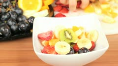 Making a fruit salad Stock Footage