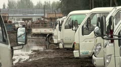 Parking a tractor at a market in Kashgar, China Stock Footage