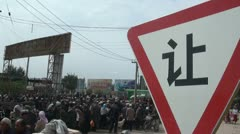Warning sign at the Kashgar animal market Stock Footage