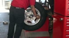 Mechanic balance truck tire on equipment P HD 0024 - stock footage
