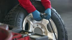 Mechanic Filling truck tire wheel with air P HD 0019 - stock footage