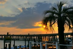 Sunset over Destin harbor  seen from marina with highway bridge in background. Stock Footage