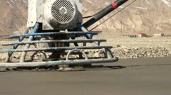 Close up of road flattening using a machine in China Stock Footage